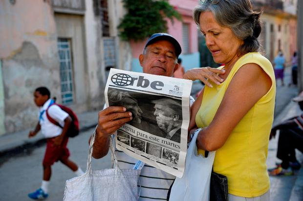Cubans read a newspaper with its front page informing of the victory of US presidential candidate Donal Trump in a street of Havana, on November 9, 2016. / AFP PHOTO / YAMIL LAGEYAMIL LAGE/AFP/Getty Images