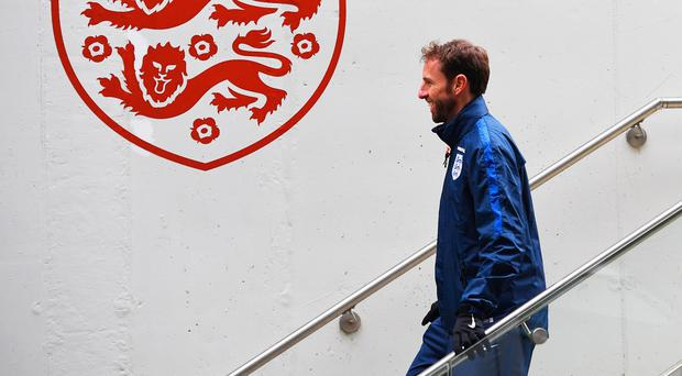 At the helm: Gareth Southgate is in temporary charge, but Adam Lallana wants a permanent appointment soon