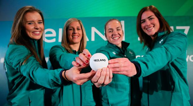 World in motion: Ireland players (from left) Claire McLaughlin, Alison Miller, Niamh Briggs and Nora Stapleton follow their side's fortunes at the 2017 Women's Rugby World Cup pool draw at Belfast City Hall yesterday