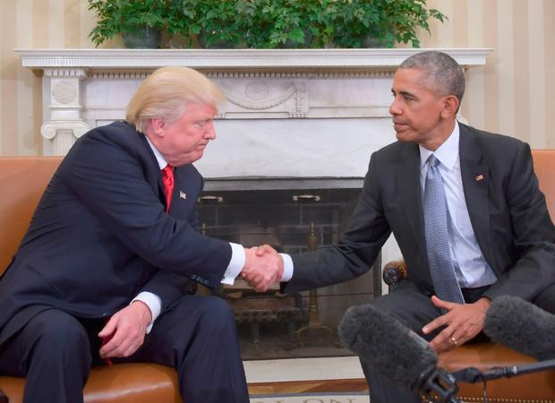 US President Barack Obama shakes hands as he meets with Republican President-elect Donald Trump on transition planning in the Oval Office at the White House on November 10, 2016 in Washington,DC. / AFP PHOTO / JIM WATSONJIM WATSON/AFP/Getty Images