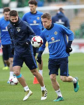 Momentum vital: Northern Ireland stars Steven Davis (right) and Oliver Norwood in training