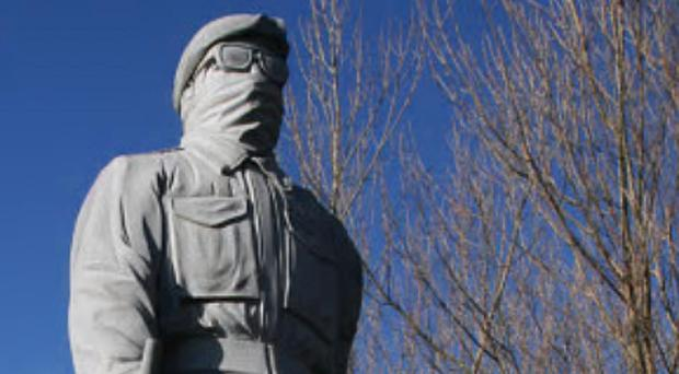 The large statue of an armed paramilitary in the City Cemetery in Londonderry