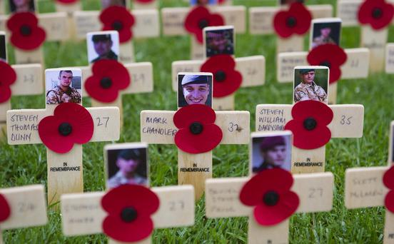 Pacemaker press 11/11/2016 Silence fell at 11:00 GMT to remember servicemen and women killed in battle. A service of rememberance was held at the cenotaph in the grounds of Belfast city hall to remember those who died giving their lives for their country. Picture Mark Marlow/pacemaker press