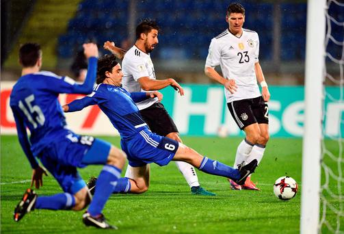 Hitting the target: Germany midfielder and captain Sami Khedira opens the scoring in the demolition job against San Marino