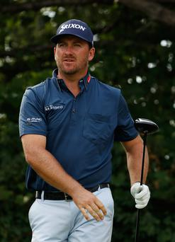 Graeme McDowell watches his drive during the first round of the RBC Canadian Open