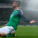 Goal kings: Kyle Lafferty celebrates scoring his sides first goal against Azerbaijan at Windsor Park last night