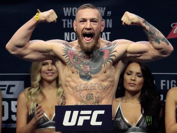 Conor McGregor stands on a scale during the weigh-in event for his fight against Eddie Alvarez in UFC 205 mixed martial arts at Madison Square Garden in New York. (AP Photo/Julio Cortez)