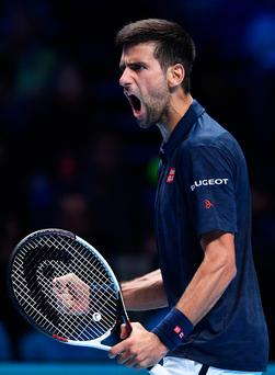 Back with a shout: Djokovic on his way to victory over Dominic Thiem in London yesterday