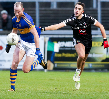 Gripping stuff: Maghery captain James Lavery is tugged back by Kilcoo's Ryan Johnston