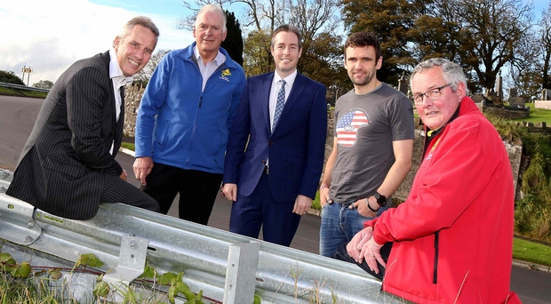 On the right track: (from left) local MP Ian Paisley, Armoy Motorcycle Road Racing Club chairman and Clerk of the Course Bill Kennedy, Communities Minister Paul Givan MLA, rider William Dunlop and club treasurer George Huey at Church Bends on the Armoy Road Races track