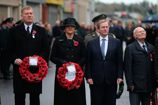 First Minister Arlene Foster and Taoiseach Enda Kenny (second right) at the service at the Cenotaph in Enniskillen