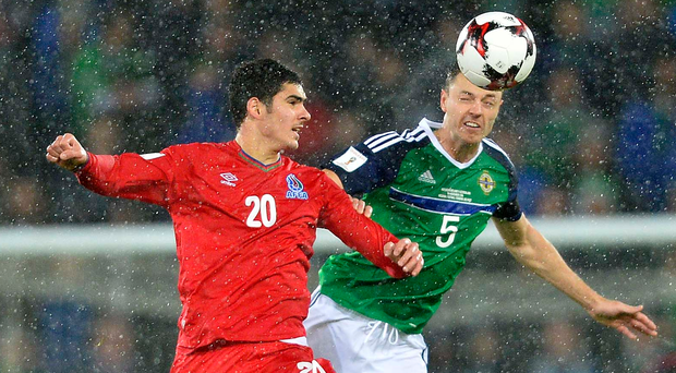Heads it's mine: Jonny Evans tussles with Azerbaijan's Ramil Sheydaev during Northern Ireland's 4-0 win