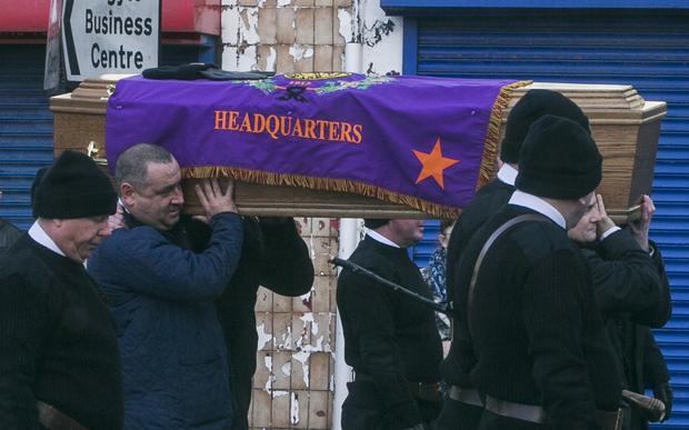 The funeral of UVF man Sam 'Pinky' Austin makes its way along the Shankill Road on Saturday morning