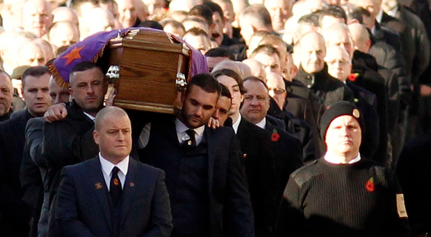 The Funeral of UVF man Sam 'Pinky' Austin makes it's way along the Shankill Road on Saturday Morning.