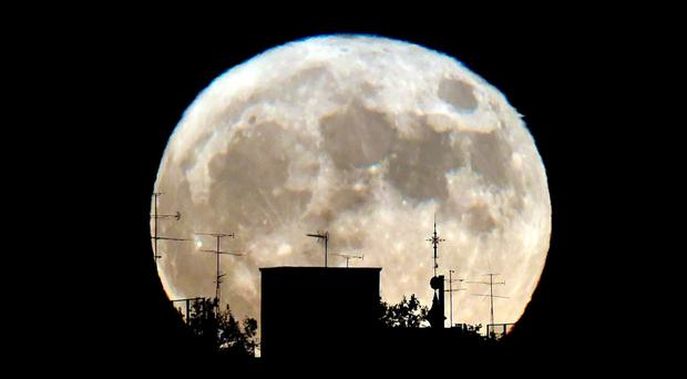 A Supermoon rises against the skyline in Madrid on November 14, 2016. The phenomenon happens when the moon is full at the same time as, or very near, perigee -- its closest point to Earth on an elliptical, monthly orbit. It was the closest to Earth since 1948 at a distance of 356,509 kilometres (221,524 miles), creating what NASA described as