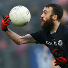 On the ball: Kilcoo's Conor Laverty has acknowledged that getting past Slaughtneil will be a massive challenge