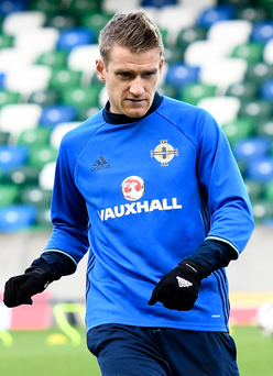 Park life: Steven Davis limbers up at Northern Ireland's training session at Windsor Park yesterday ahead of tonight's clash with Croatia