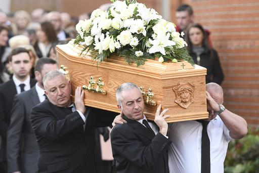 Family and friends during the funeral of Kevin Kearney which took place at Holy Family Church in North Belfast. Picture Colm Lenaghan/ Pacemaker