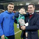 Zak Brennan on the pitch with dad Garath and Aaron Hughes during the Northern Ireland and Croatia game at Windsor Park on November 15th 2016 in Belfast , Northern Ireland. (Photo William Cherry / Presseye)