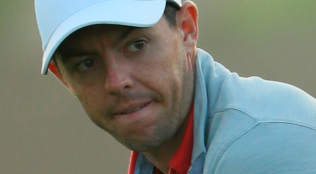 Busy schedule: McIlroy during the pro-am in Dubai yesterday