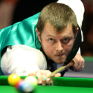 On cue: Mark Allen potting his way to a 4-1 victory over Mark Joyce last night at the Titanic Exhibition Centre