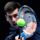 Hanging in: Novak Djokovic en route to victory