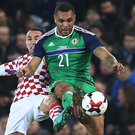 Hold up: Josh Magennis shields possession from Marin Leovac