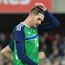 Frustrated: Kyle Lafferty shows his disappointment as Northern Ireland fall to a rare home defeat