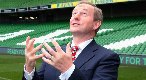 Taoiseach Enda Kenny (centre) with Dick Spring, Chairman of Ireland's Bid Oversight Board (left) and Philip Browne, CEO of the IRFU, at the Aviva Stadium to announcement Ireland's bid to host the 2023 Rugby World Cup
