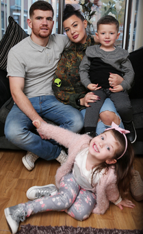 Home comforts: Paddy Gallagher at home in west Belfast with partner Rachel, daughter Amber (5) and son Ronan (3)