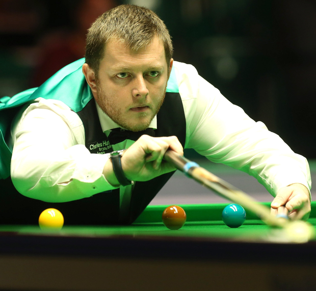 Pocketing the prize: Mark Allen blasts his way to a 4-2 win over Michael Georgiou at the Titanic Exhibition Centre yesterday