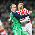 Pressure is on: Liam Boyce with Croatia's Matej Mitrovic