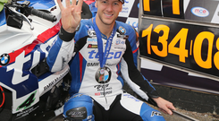 To the four: Ian Hutchinson hails his four victories in one day at this year's UGP