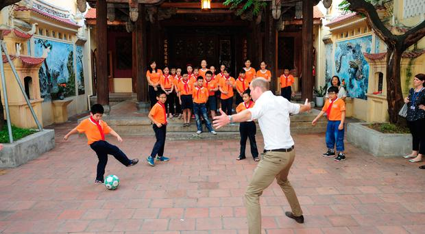 Duke of Cambridge playing football during a visit to Hong Ha primary school in Hanoi. Pic: Kensington Palace/PA Wire