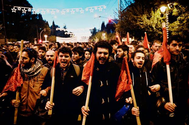 Protesters holding red flags demonstrate, in central Athens on November 17, 2016, to commemorate a student uprising that helped bring down a US-backed junta in 1974. AFP/Getty Images