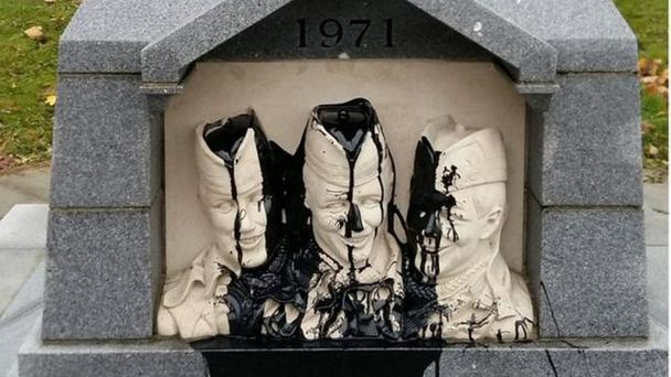 The vandalised memorial to Royal Highland Fusiliers killed by the IRA in March 1971