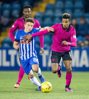 Kilmarnock's Adam Frizzell (left) and Celtic's Scott Sinclair battle for the ball during the Ladbrokes Scottish Premiership match at Rugby Park, Kilmarnock. Photo credit: Jeff Holmes/PA Wire.