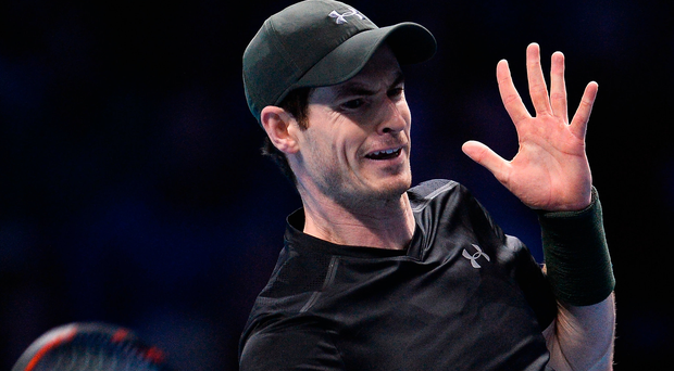 Powering through: Andy Murray on his way to victory over Stan Wawrinka at the O2 Arena in London yesterday