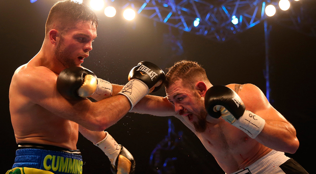 Setback: Conrad Cummings fends off Ronnie Mittag who had plenty of battle scars to show at the end