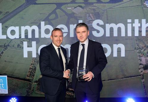 Martin Mallon, of Lambert Smith Hampton is presented with the 2016 Property Deal of the Year award by Neil Logan of Wilson Nesbitt Solicitors. Lambert Smith Hampton - which has a major Belfast office - is being put on the market by its owners, according to reports