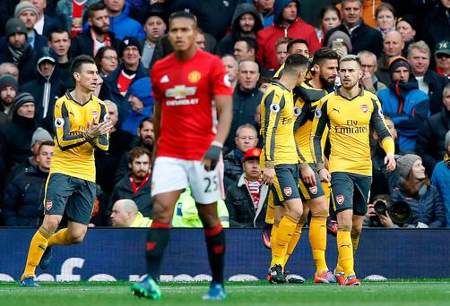Arsenal's Olivier Giroud (second from right) celebrates scoring his side's first goal of the game with teammates during the Premier League match at Old Trafford, Manchester.