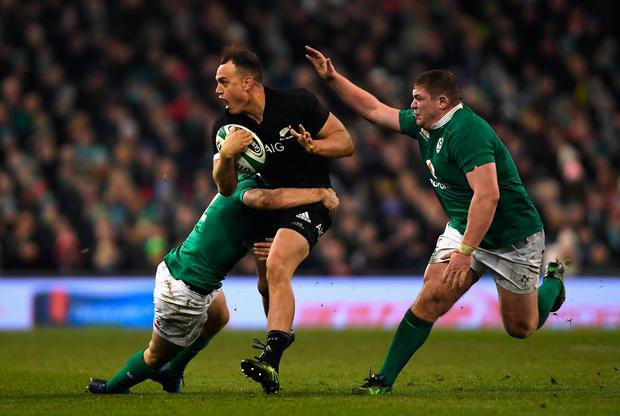 DUBLIN, IRELAND - NOVEMBER 19: Israel Dagg of New Zealand (C) is tackled by Jackson of Ireland (L) and Tadhg Furlong of Ireland (R) during the International match between Ireland and New Zealand All Blacks at Aviva Stadium on November 19, 2016 in Dublin, Ireland. (Photo by Mike Hewitt/Getty Images)