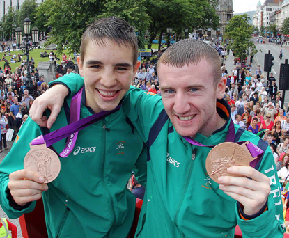 Olympic veterans: Michael Conlan with pal Paddy Barnes and their London 2012 bronze medals