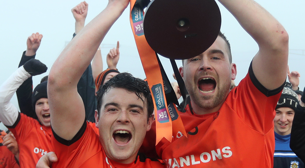 Party time: Joint captains Conor Laverty and Liam Cassley lift the glittering prize
