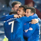 Late show: Harry Forrester is mobbed by team-mates after scoring Rangers' added-time winner