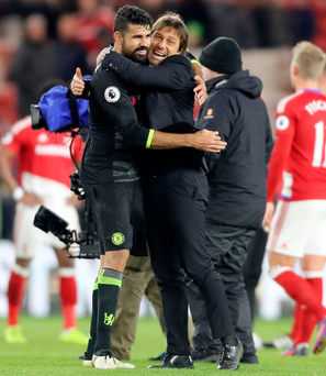 My man: Chelsea manager Antonio Conte embraces scorer Diego Costa