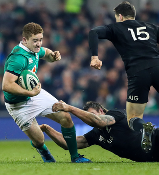 Gripping stuff: Ireland's Paddy Jackson is tackled by Liam Squire of New Zealand