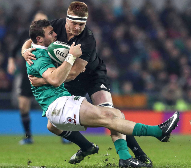 Robbie Henshaw is tackled