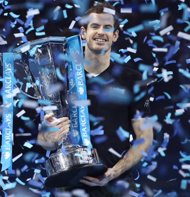 Prize guy: Andy Murray beams with delight after lifting the Barclays ATP World Tour Finals title in London