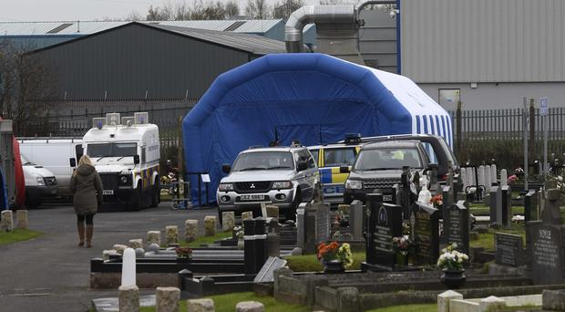 Police forensic teams begin exhuming the body of Daniel Rooney, Mr Rooney was shot dead by the Army in 1972 at the St James Crescent area of west Belfast. His Body is being exhumed as part of an investigation into the Military Reaction Force (MRF). Pic Colm Lenaghan/Pacemaker